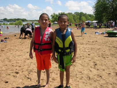 These young boys know how to stay safe at the lake - Wear your Life Jacket!!