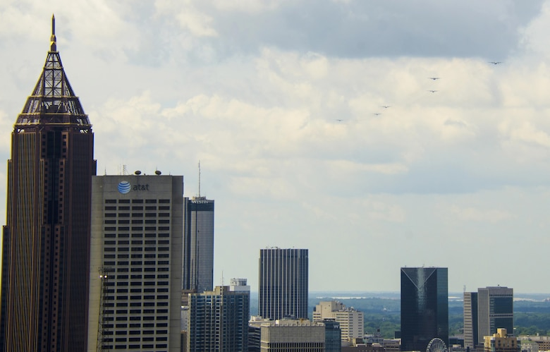 A six-ship C-130 Hercules formation from Dobbins Air Reserve Base, Ga., flies over downtown Atlanta on July 9, 2016. The 94th Airlift Wing conducted proficiency training missions over downtown Atlanta and much of the metro area. (U.S. Air Force photo/Staff Sgt. Daniel Phelps)
