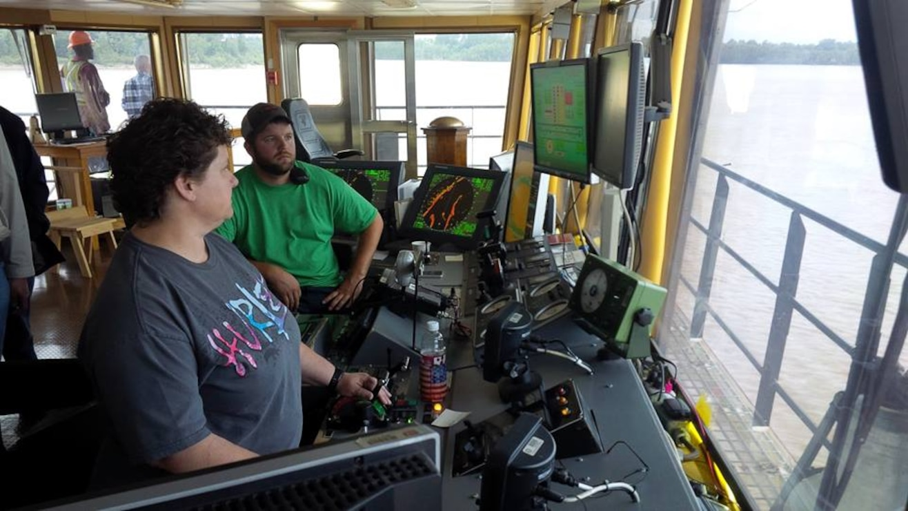In the pilot house of the USACE Memphis District Dredge Hurley, Stacye Sinn operates the suction to remove silt from the channel as Kendall Turman keeps the Dredge on course.