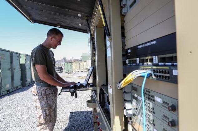 U.S. Marine Cpl. Matthew Peterson works on communication equipment during Command Post Exercise 3 aboard Camp Pendleton, Calif., June 28, 2016. Peterson is a field radio operator with Communications Company, Headquarters Regiment, 1st Marine Logistics Group. During the exercise, Marines with Communications Company proved they could communicate not only within their own subordinate and adjacent units, but also 3rd Marine Air Craft Wing, 1st Marine Division, and I Marine Expeditionary Force. (U.S. Marine Corps photo by Sgt. Laura Gauna/ Released)