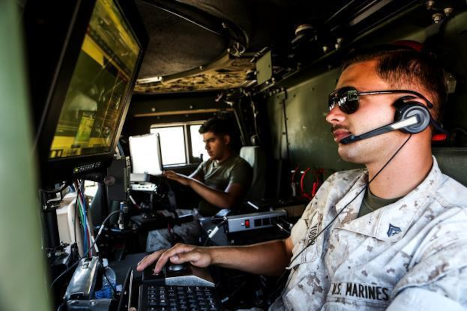 U.S. Marine Cpl. James Yoder conducts radio checks during Command Post Exercise 3 aboard Camp Pendleton, Calif., June 28, 2016. Yoder is a technical controller with Communications Company, Headquarters Regiment, 1st Marine Logistics Group. During the exercise, Marines with Communications Company proved they could communicate not only within their own subordinate and adjacent units, but also 3rd Marine Air Craft Wing, 1st Marine Division, and I Marine Expeditionary Force. (U.S. Marine Corps photo by Sgt. Laura Gauna/ Released)
