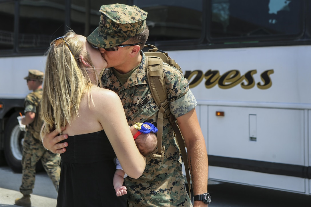 Marine Corps Lance Cpl. Hunter Kussman embraces his family during a homecoming ceremony on Camp Lejeune, N.C., July 10, 2016. The Marines trained with fellow NATO countries to improve international relations and stability, solidifying international cohesion in the event of necessary multinational contingency missions. Kussman is a a cyber-network operator assigned to the Black Sea Rotational Force. Marine Corps Photo by Cpl. Shannon Kroening