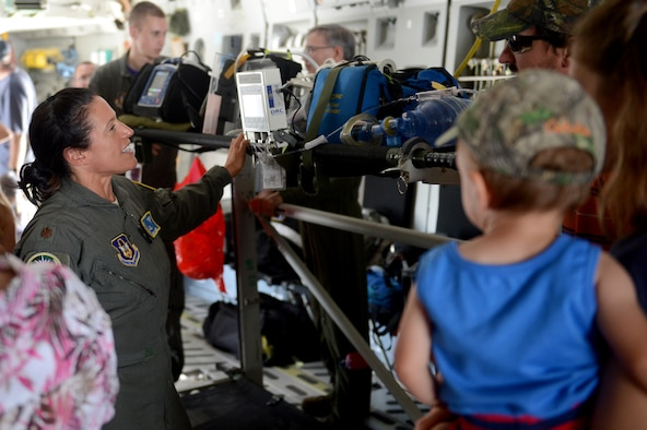 Maj. Carolyn Concia, a flight nurse with the 446th Aeromedical Evacuation Squadron, demonstrates medical equipment during the during the 50th Anniversary of the Port of Moses Lake July 1, 2016 at Grant County International Airport, Wash. (U.S. Air Force photo/Senior Airman Divine Cox)