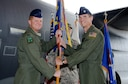 U.S. Air Force Col. William Freeman, 353rd Special Operations Group commander, passes the guidon to U.S. Air Force Lt. Col. Christopher Lang, 17th Special Operations Squadron commander, during the 17th SOS change of command ceremony on Kadena Air Base, Japan, July 8, 2016.   (U.S. Air Force photo by Master Sgt. Kristine Dreyer)