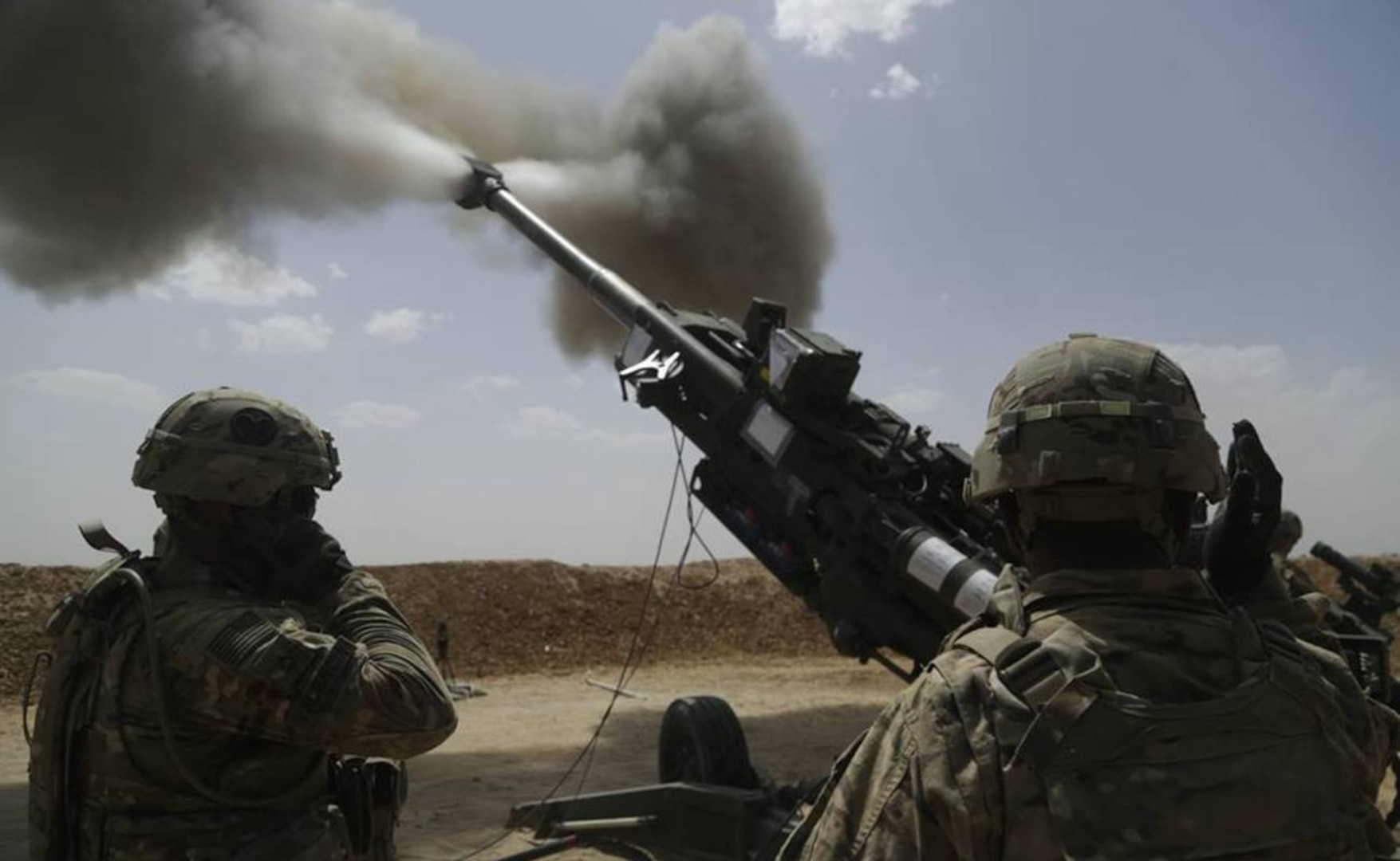 U.S. Soldiers with 1st Battalion, 320th Field Artillery Regiment, 2nd Brigade Combat Team, 101st Airborne Division (Air Assault), fire an M777 howitzer at Kara Soar Base, Iraq,in May. According to Defense Secretary Ash Carter, they'll be joined soon by an additional 560 U.S. troops.  (U.S Army photo by Sgt. Paul Sale)