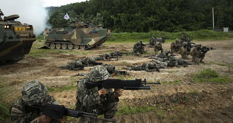 U.S. and Republic of Korea Marines sight in side-by-side in front of ROK Assault Amphibious Vehicles July 6, 2016 at Suseong Range, South Korea, during a Korean Marine Exchange Program. The goal of the KMEP is to sustain the combined force and enhance the ROK-U.S. team at the tactical level to build combined warfighting capabilities. During this exercise the Marines carried out a bilateral regimental-sized Marine Air Ground Task Force operation for the first time. The ROK Marines were a part of 73rd Battalion, 7th Regiment, 1st Marine Division. The U.S. service members are a part of 2nd platoon, Fox Company, 2nd Battalion, 2nd Marine Regiment, currently attached to 4th Marine Regiment, III Marine Expeditionary Force through the unit deployment program. (U.S. Marine Corps photo by Lance Cpl. Amaia Unanue/ Released)