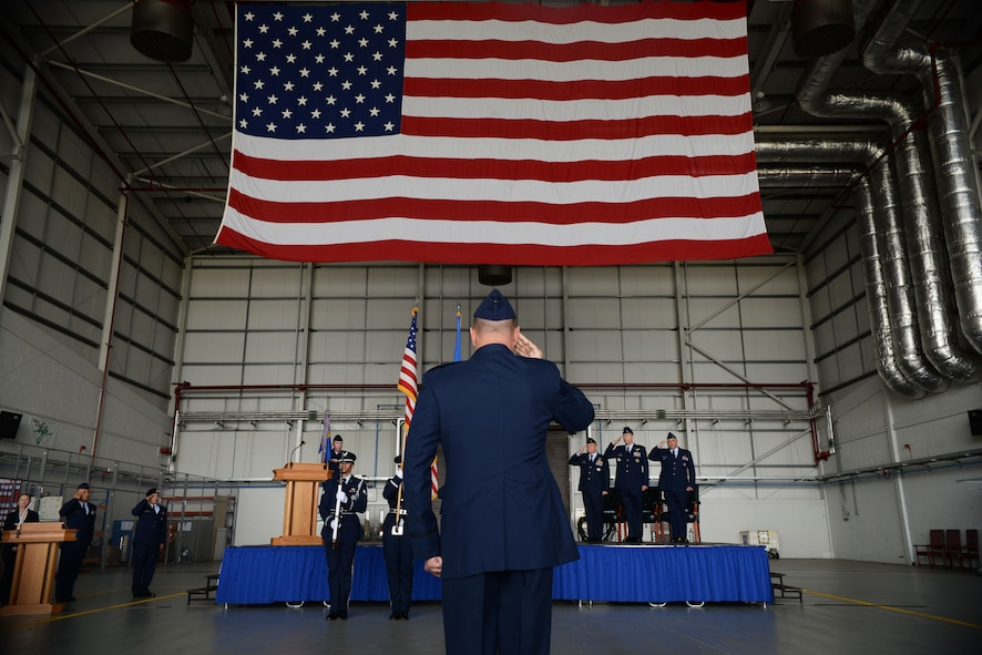 U.S. Air Force Airmen from the 100th Mission Support Group salute the American Flag June 29, 2016, during a change of command ceremony on RAF Mildenhall, England. During the ceremony, U.S. Air Force Col. Robert Hoskins assumed command of the 100th MSG. (U.S. Air Force photo by Airman 1st Class Tenley Long/Released)