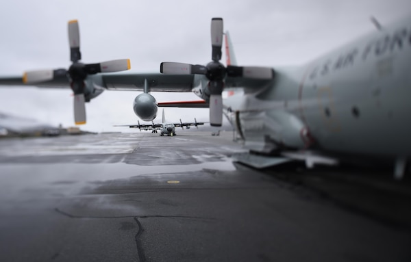 """LC-130 """"Skibirds"""" from the New York Air National Guard's 109th Airlift Wing in Scoita, New York, sit on the runway at Kangerlussuaq, Greenland, on June 27, 2016. Four LC-130s and 80 Airmen from the Wing recently completed the third rotation of the 2016 Greenland season. Airmen and aircraft for the 109th Airlift Wing stage out of Kangerlussuaq, Greenland, during the summer months, supplying fuel and supplies and transporting passengers in and out of various National Science Foundation camps throughout the entire season and also train for the Operation Deep Freeze mission in Antarctica. The unique capabilities of the ski-equipped LC-130 aircraft make it the only one of its kind in the U.S. military, able to land on snow and ice."""