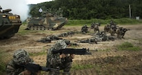 U.S. and Republic of Korea Marines sight in side-by-side in front of ROK Assault Amphibious Vehicles during a Korean Marine Exchange Program at Suseong Range, South Korea, July 6,2016. The goal of the KMEP is to sustain the combined force and enhance the ROK-U.S. team at the tactical level to build combined warfighting capabilities. During this exercise the Marines carried out a bilateral regimental-sized Marine Air Ground Task Force operation for the first time.