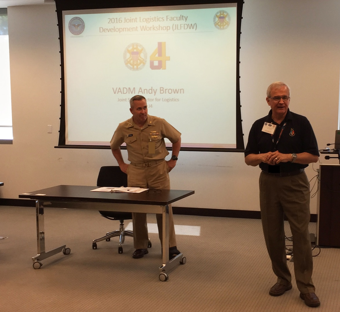 Navy Vice Admiral Andy Brown, Joint Staff Director for Logistics (left), is introduced by Lt Gen (Ret) Chris Kelly, Director of the Center for Joint & Strategic Logistics, prior to offering his insights and guidance to over 30 faculty and logistics staff members in attendance for the 2016 Joint Logistics Faculty Development Workshop.