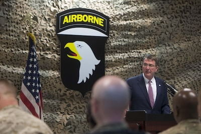 Defense Secretary Ash Carter speaks with service members during a troop event in Baghdad.