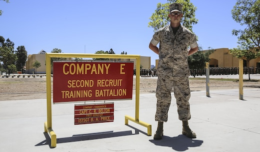 Private Richard A. Faler, Echo Company, 2nd Recruit Training Battalion, stands next to his squad bay at Marine Corps Recruit Depot San Diego, July 5. Following recruit training, Faler will continue his schooling at Marine Combat Training at Marine Corps Base Camp Pendleton, Calif., and then on to his military occupational specialty school to learn his profession of communications. Annually, more than 17,000 males recruited from the Western Recruiting Region are trained at MCRD San Diego. Echo Company is scheduled to graduate July 8.