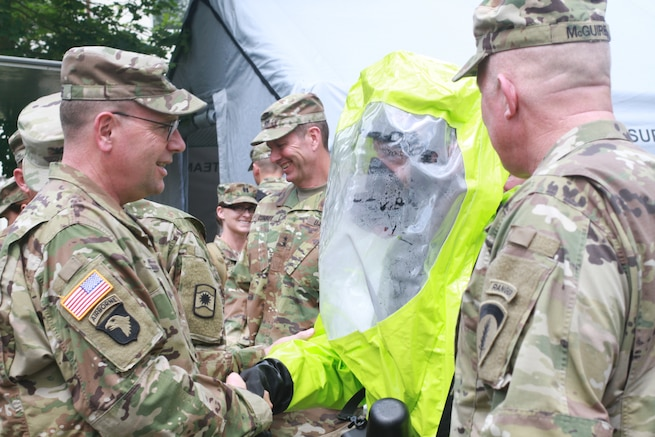 KAISERSLAUTERN, Germany- Lt. Gen. Frederick B. Hodges, commanding general U.S. Army Europe, shakes hands with a Soldier in a chemical protective suit during a visit to Daenner Kaserne on July 9, 2016. Hodges emphasized the U.S. Army and Army Reserve's strategic role in Europe against both conventional and unconventional threats. (U.S. Army photo by Sgt. Daniel J. Friedberg, 7th Mission Support Command Public Affairs Office)
