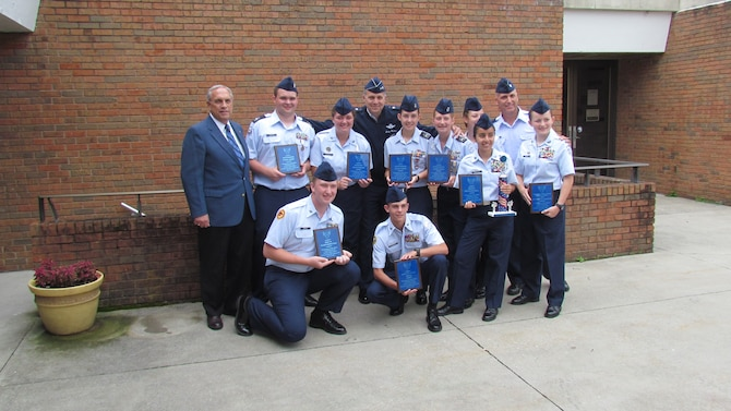 Major Gen. Jerry Martinez (center), the director of operations for Air Mobility Command, poses with Air Force JROTC cadets and was the guest speaker for the graduation event for the 'Mountaineer Cadet Officer Leadership School,' held in Athens, West Virginia, June 19-25. (Courtesy photo)