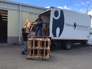 Chairs no longer needed by Marine Corps Base Hawaii are loaded for transport to a local charity to help those in need instead of becoming waste.