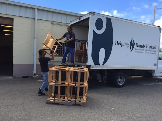 Chairs no longer needed by Marine Corps Base Hawaii are loaded for transport to a local charity to help those in need instead of becoming waste. Photo by
