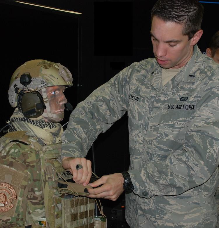 First Lt. Anthony Eastin clips the tablet into the Bat Rack, a mounting device created by the Battlefield Air Targeting Man-Aided Knowledge team in the 711th Human Performance Wing's Airman Systems Directorate. This mounting device enables operators to carry and easily access their tablets. (U.S. Air Force photo/Gina Marie Giardina)
