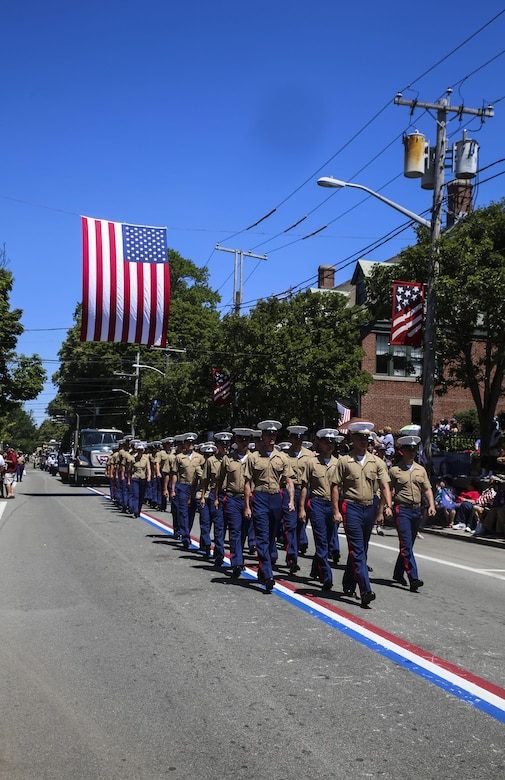 Marines with 8th Communication Battalion march during the Bristol Fourth of July Parade in Bristol, Rhode Island, July 4, 2016. Marines marched directly behind the sailors of the USS Arlington and Navy officer candidates from Naval Officer Training Command Newport, RI. (U.S. Marine Corps photo by Cpl. Paul S. Martinez/Released)