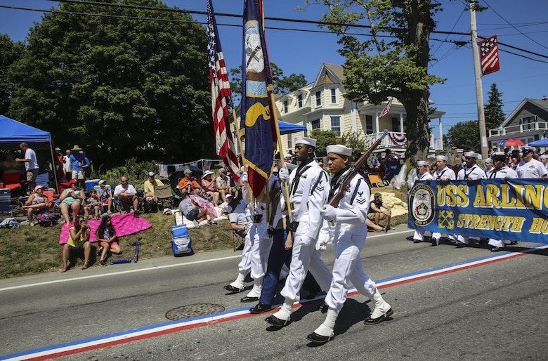 The color guard representing the USS Arlington marches during the Bristol Fourth of July Parade in Bristol, Rhode Island, July 4, 2016. Marines marched directly behind the sailors of the USS Arlington and Navy officer candidates from Naval Officer Training Command Newport, RI. (U.S. Marine Corps photo by Cpl. Paul S. Martinez/Released)