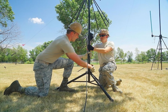 Staff Sgt. Randall J. O'Shea, Cyber Transport Operations Technician, and Airman Justin T. Alt, Radio Transmissions Technician, adjust a Very High Frequency Antenna on July 12, 2016 at the Niagara Falls Air Reserve Station. The antenna is part of a communications package for the Air Force Reserve Command Joint Incident Site Communications Capability UTC deployment taking place on base. (U.S. Air Force photo by Staff Sgt. Richard Mekkri)