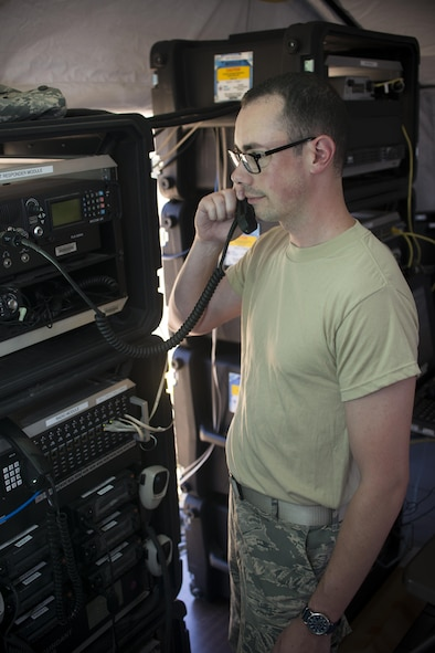Tech. Sgt. Ryan Schmidt, Network Infrastructure Specialist, 914 Communication Squadron, tests equipment during the Air Force Reserve Command Joint Incident Site Communications Capability (JISCC) exercise, July 12, 2016, Niagara Falls Air Reserve Station, N.Y. The exercise is meant to simulate how units would deploy anywhere in the U.S. to enable inter-agency communication during a man-made or natural disaster. (U.S. Air Force photo by Tech. Sgt. Stephanie Sawyer)