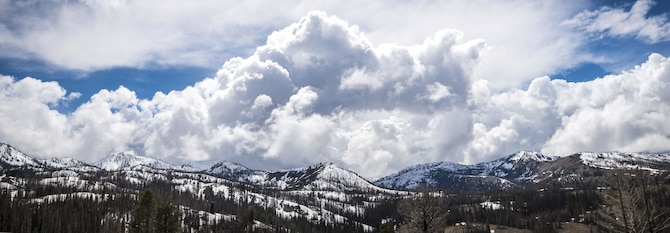 Clouds build in the distance of Rainbow Basin in Boise National Forest, Idaho, May 15, 2015. Snow will often linger on the mountains of the Boise National Forest for the spring and even into the early summer. (U.S. Air Force photo by Airman 1st Class Connor J. Marth/RELEASED)