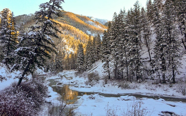 The setting sun shines on a mountain near Rainbow Basin in the Boise National Forest, Idaho, 2015. Streams and rivers between mountains are often home to trout and other small fish. (Courtesy photo by Aj Workinger/RELEASED)