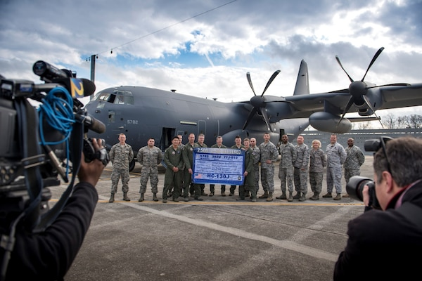 Air Force Col. Sheri Bennington, commander of Defense Contract Management Agency Lockheed Martin Marietta, joined airmen from the 71st Rescue Squadron and the 71st Aircraft Maintenance Unit in front of an HC-130J Combat King II, Dec. 11, at the Lockheed Martin C-130 ramp in Marietta, Georgia. The aircraft is the 2,500th C-130 delivered by Lockheed Martin.