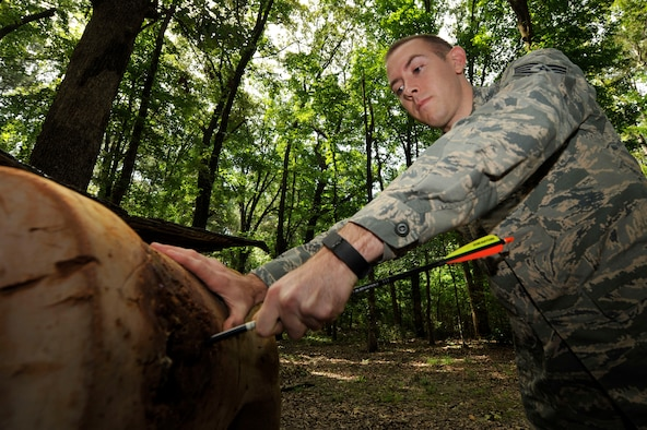 U.S. Air Force Staff Sgt. Nathan Busk, 19th Aircraft Maintenance Squadron aircraft hydraulics systems journeyman, removes an arrow from a fake deer July 12, 2016, at Little Rock Air Force Base, Ark. Busk has been working on cleaning up the range for nearly a year in hopes of re-opening it. (U.S. Air Force photo by Senior Airman Stephanie Serrano)