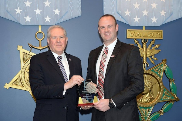 Frank Kendall, the undersecretary of defense for acquisition, technology and logistics, presented Ryan Connell, an Integrated Cost Analysis Team pricing lead at Defense Contract Management Agency Raytheon Tewksbury in Massachusetts, with a 2015 Defense Acquisition Workforce Individual Achievement and Development Award during a Pentagon ceremony Dec. 10.