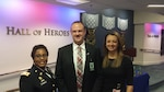 Army Col. Delisa Hernandez, director of Defense Contract Management Agency Raytheon Tewksbury in Massachusetts, and Jennifer Connell, wife of DCMA employee Ryan Connell, congratulate him on receiving a 2015 Defense Acquisition Workforce Individual Achievement and Development Award Dec. 10.