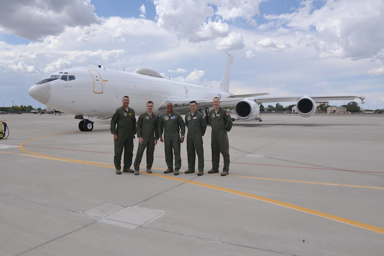 Maj. Gen. Anthony Cotton, 20th Air Force and Task Force 214 commander, center, takes a photo with, from left to right, Lt. Col. Christopher Picinni, Airborne National Command Post mission commander, Capt. Nate Larson, 90 Operations Support Squadron, Capt. Kerry Dubuisson, 91 Operations Support Squadron, Capt. Greg Carter, ALCS/Intel Officer and Strike Planner June 26, 2016.