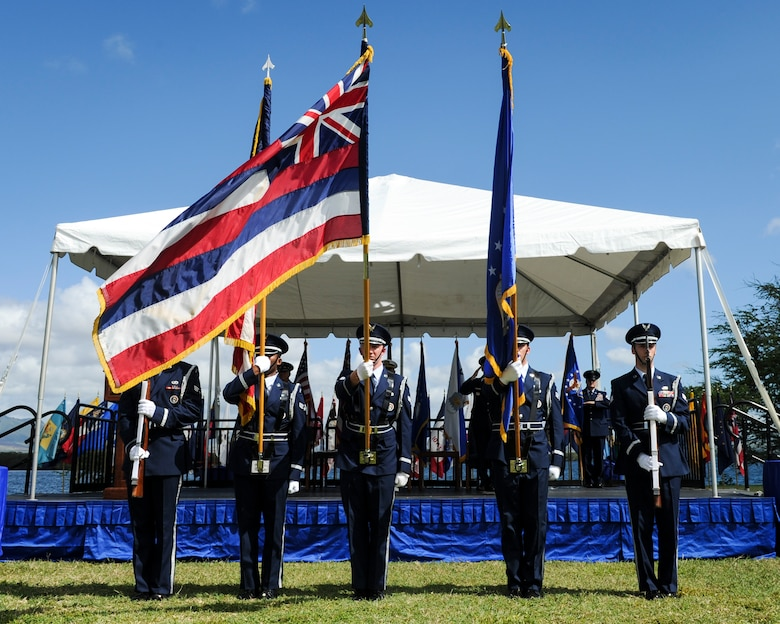 The 15th Wing Honor Guard presents the colors during an assumption-of-command ceremony at Joint Base Pearl Harbor-Hickam, Hawaii, July 12, 2016. During the ceremony, Gen. Terrence J. O'Shaughnessy assumed command of Pacific Air Forces. (U.S. Air Force photo by Staff Sgt. Kamaile Chan)