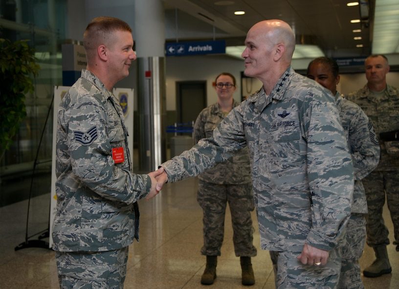 Gen. Carlton D. Everhart II, Air Mobility Command commander, coins Staff Sgt. Frank Brooks, 731st Air Mobility Squadron passenger services supervisor, for being a star performer at the Osan passenger terminal July 11, 2016, at Osan Air Base, Republic of Korea. While visiting Osan AB, the general had lunch with the Airmen from the 731st AMS and toured their facilities to interact with the Airmen and civilians who work to provide precise, reliable airlift worldwide every day. (U.S. Air Force photo byTech. Sgt. Rasheen Douglas/Released)