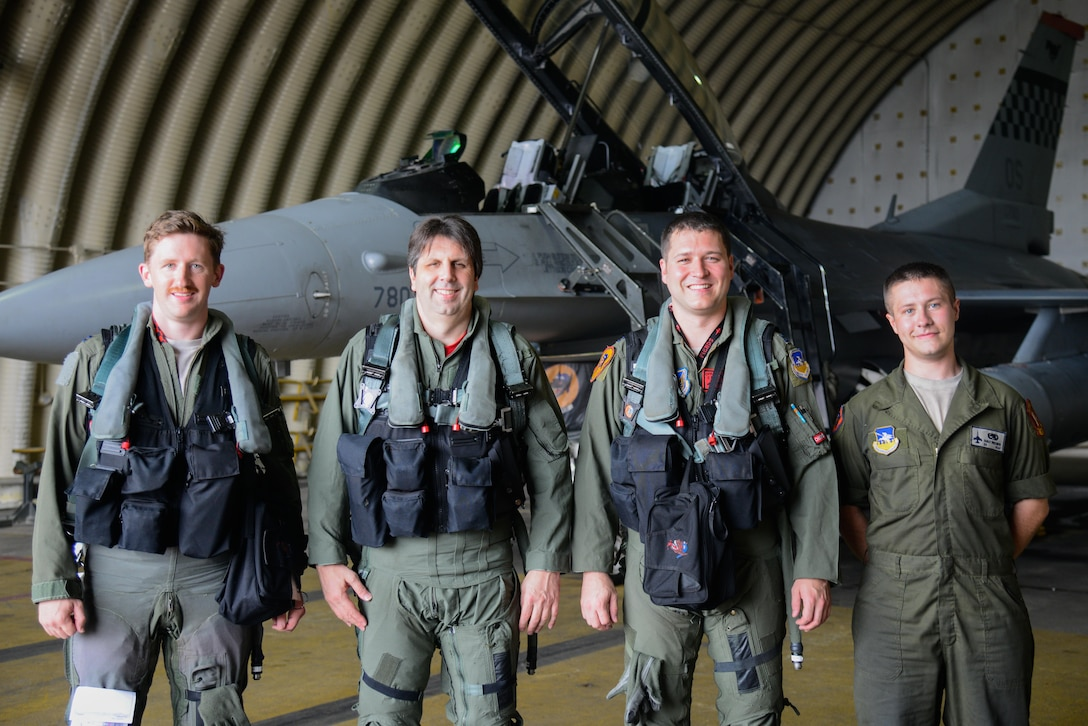 U.S. Ambassador to the Republic of Korea Mark Lippert, second from left, poses for a photo with Osan Airmen before a familiarization flight in an F-16 Fighting Falcon at Osan Air Base, Republic of Korea, July 12, 2016. Lippert flew in the aircraft to better understand Seventh Air Force's role in the defense of the RoK as part of United States Forces Korea. (U.S. Air Force photo by Senior Airman Dillian Bamman/Released)