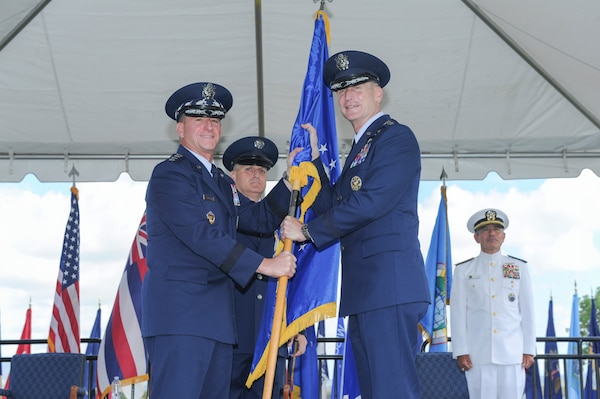 Gen. Terrence J. O'Shaughnessy receives the Pacific Air Forces banner from Gen. David L. Goldfein, U.S. Air Force Chief of Staff, during an assumption-of-command ceremony at Joint Base Pearl Harbor-Hickam, Hawaii, July 12, 2016. O'Shaughnessy was promoted to general prior to the ceremony, attended by Goldfein, and Adm. Harry B. Harris, Jr., U.S. Pacific Command commander. (U.S. Air Force photo by Staff Sgt. Kamaile Chan)