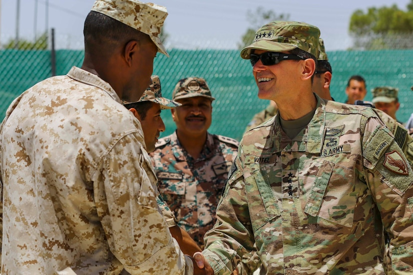 U.S. Army Gen. Joseph Votel Commander of U.S. Central Command, meets with U.S. Marine Sgt. Maj. Clifford Wiggins, Command Sgt. Maj. 5th Marine Expeditionary Brigade, and members of the Jordanian Armed Forces during Exercise Eager Lion 16 near Amman, Jordan on May 22, 2016. Eager Lion 16 is a US military bi-lateral exercise with the Hashemite Kingdom of Jordan designed to strengthen relationships and interoperability between partner nations. (U.S. Marine Corps photo by Cpl. Lauren Falk 5th MEB COMCAM/Released)