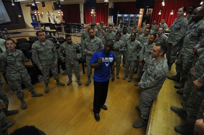 Retired U.S. Air Force Chief Master Sgt. Juan Lewis, known as the Fired Up Chief, speaks to NCOs during a Tier II private organization meeting at the Brick House on Spangdahlem Air Base, Germany, July 12, 2016. Lewis invited the NCOs in the audience to the front of the stage to pose for a group photo at the conclusion of his presentation. (U.S. Air Force Photo by Staff Sgt. Joe W. McFadden/Released)