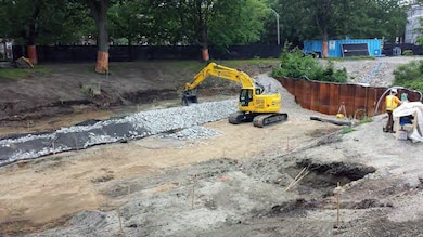 Bank stabilization/construction with stone protection at Upper Fens Pond – early June 2015.