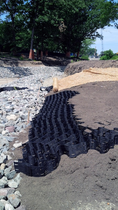 Note the geocells and turf reinforcement mattress being installed – early July 2015.