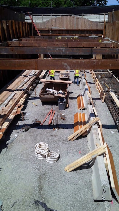 Right (looking downstream) concrete pile cap curing; and reinforcement and formwork being installed at the left pile cap for the new precast concrete Riverway Culvert – mid July 2015.