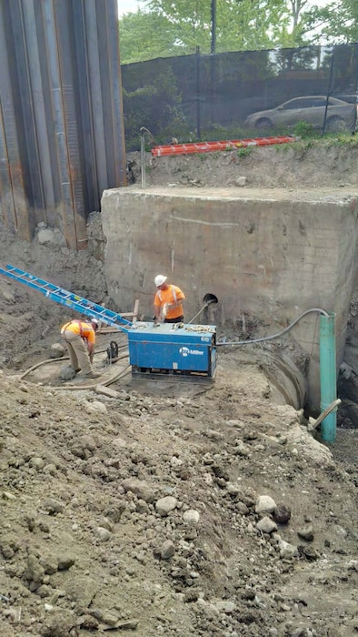 "Upstream of Existing Avenue Louis Pasteur – View of existing concrete junction box and twin 72"" culverts – late July 2015."