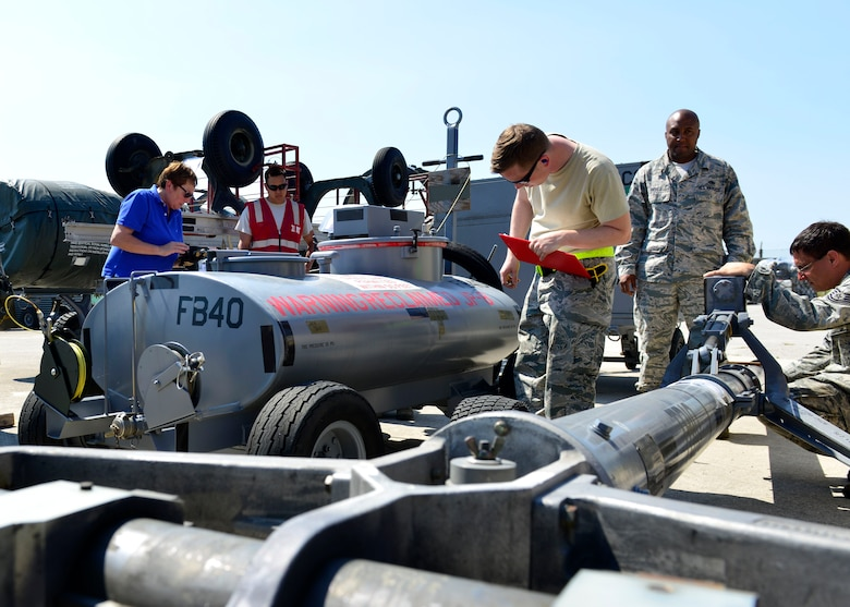 Team Aviano members inspect cargo, June 29, 2016, at Aviano Air Base, Italy, in preparation for Exercise Red Flag 16-3 at Nellis Air Force Base, Nev. Airmen from the 31st Maintenance Group, 31st Logistics Readiness Squadron and 724th Air Mobility Squadron teamed up to inspect and clear all cargo before it was flown to Nellis AFB for the exercise. (U.S. Air Force photo by Airman 1st Class Cary Smith/Released)