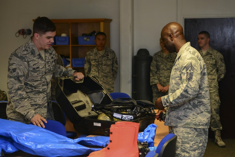 U.S. Air Force Senior Airman Alexander Orlando, 39th Civil Engineer Squadron logistics section, shows Chief Master Sgt. Vegas Clark, 39th Air Base Wing command chief, emergency management equipment July 13, 2016, at Incirlik Air Base, Turkey. The equipment is used for collecting and sampling evidence and substances. (U.S. Air Force photo by Tech. Sgt. Caleb Pierce)
