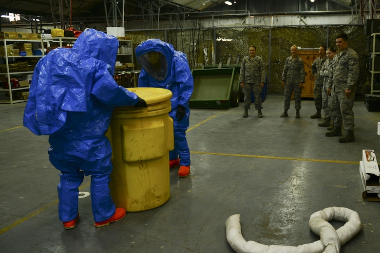 U.S. Air Force Chief Master Sgt. Vegas Clark, 39th Air Base Wing command chief, and Staff Sgt. Joshua Bartley, 39th Civil Engineer Squadron (CES) emergency management journeyman, secure a barrel of liquid that was simulated spilled July 13, 2016, at Incirlik Air Base, Turkey. The 39th CES readiness and emergency management flight is responsible for preparing for, responding to, and recovering from any incident that occurs on Incirlik. (U.S. Air Force photo by Tech. Sgt. Caleb Pierce)