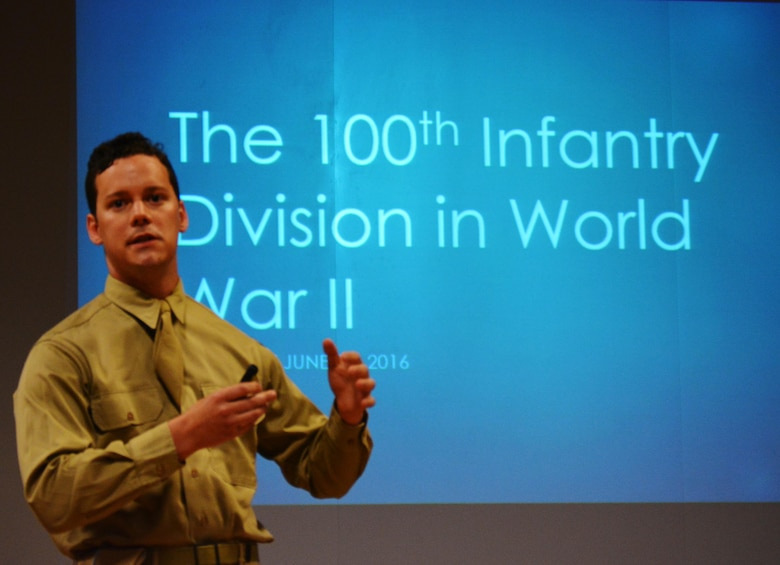 Tom Kelly paints a vivid picture of brutal ground combat mixed with an insurmountable dedication to duty, honor, and country fulfilled by 100th Infantry Division Soldiers during a presentation before Army Reserve Soldiers currently assigned to the 100th Training Division headquarters. Kelly and his partner Joshua Kerner, founded the 100th Infantry Division (reenacted), a civilian organization that uses authentic uniforms and equipment to accurately and respectfully recreate WW II events pertaining to the 100th ID.