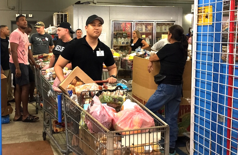 US Army 1st Lt. Aaron Bae from the 301st Public Affairs Detachment, Army Reserve prepares to assist with delivering food to needy locals at a Mesa, Ariz. food bank.