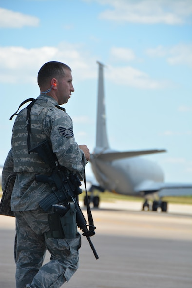 Tech. Sgt. David Whisenhunt, 507th Security Forces Squadron mans the entry control point on the Tinker Air Force Base flight line while KC-135R Stratotankers taxi in response to an exercise input during the June Operational Exercise June 5, 2016. (U.S. Air Force Photo/Maj. Jon Quinlan)