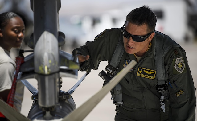 Maj. Kyle Ruthford, an F-16 Fighting Falcon pilot from Shaw Air Force Base's 79th Fighter Squadron, conducts pre-flight inspections day 1 of Red Flag, July 11, 2016 at Nellis Air Force Base, Nevada. The exercise will test participants'' ability to operate in air, cyberspace and space. (U.S. Air Force photo/Tech. Sgt. David Salanitri)