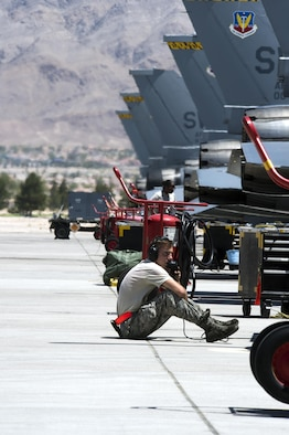 Airman 1st Class Shawn Kelly, 79th Aircraft Maintenance Unit crew chief, prepares an F-16 Fighting Falcon for a flight mission during Red Flag 16-3 at Nellis Air Force Base, Nevada, Monday, July 11, 2016. Although the exercise will test all participating units, 16-3 will provide a deeper understanding on space and cyber systems capabilities and how they contribute to the multi-domain aspect of the operation. (U.S. Air Force photo/Tech. Sgt. Julius Delos Reyes)